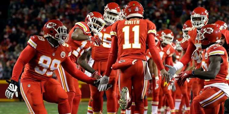 Kansas City Chiefs players welcoming teammate into field