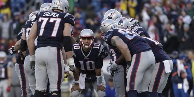 New England Patriots team gathered around