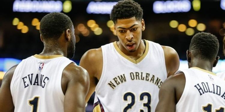 New Orleans Pelicans players gathered around