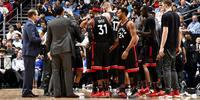 Toronto Raptors team gathered around