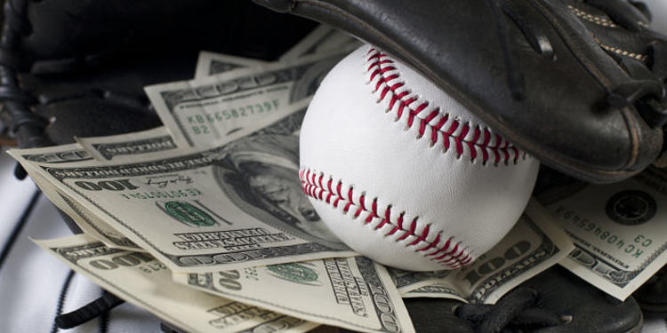Baseball glove filled with money