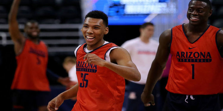 Arizona Wildcats NCAA basketball team players celebrating first round victory during 2017 Tourney