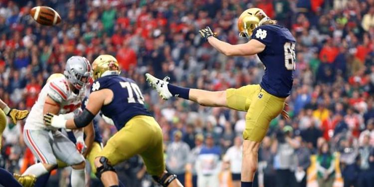 Notre Dame player kicking ball