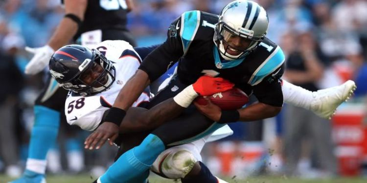 Von Miller Tackling Cam Newton On The Football Field