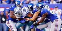 Giants Players Trying To Take The Ball From Cowboys TE Jason Witten