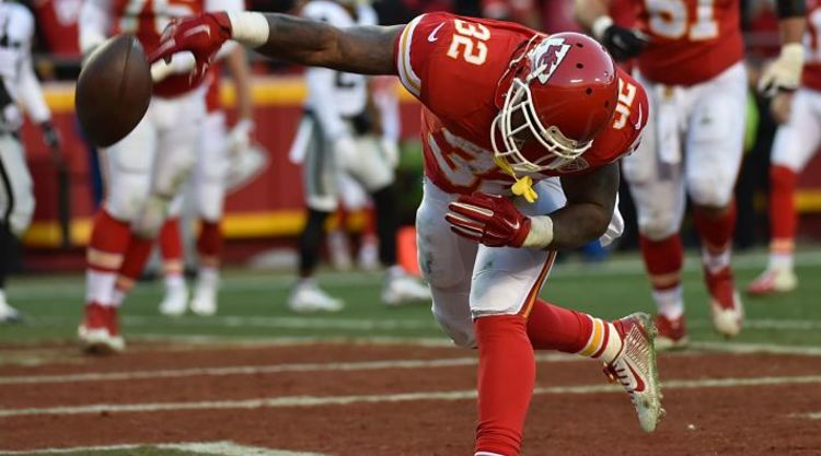 Kansas City Chiefs Player Spikes football