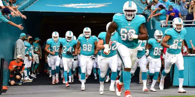 Miami Dolphins team running into the field