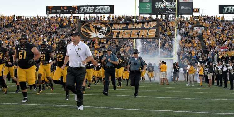 Missouri Tigers team running into the field