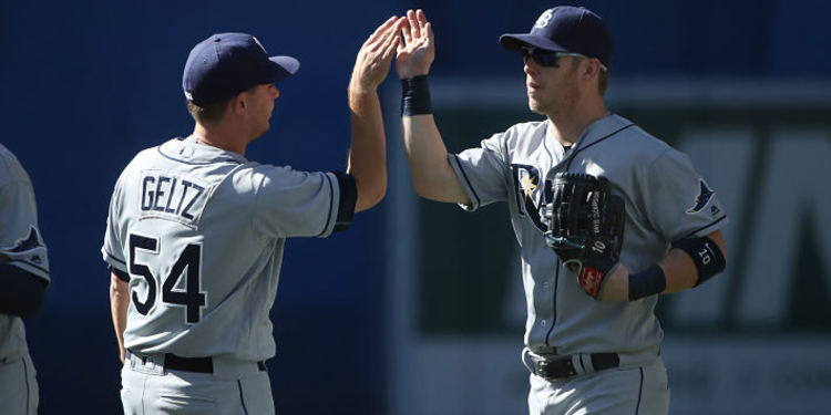 Tampa Bay Rays teammates greeting each other