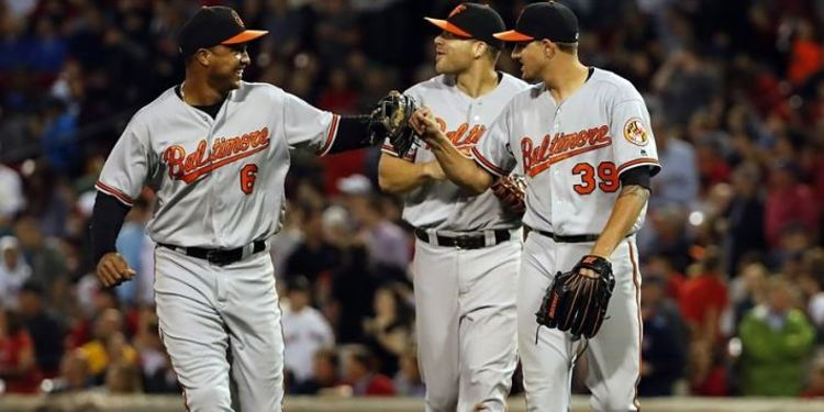 Baltimore Orioles teammates celebrating in field