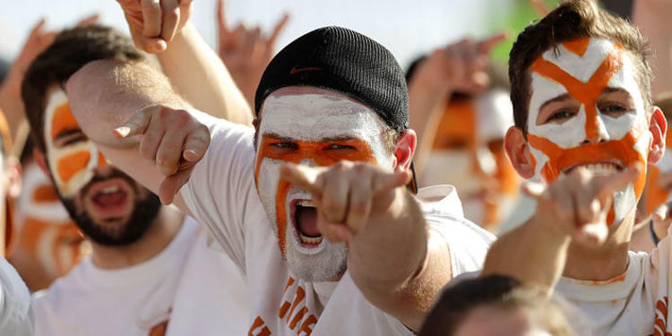 Texas Longhorns fans cheering with their face painted
