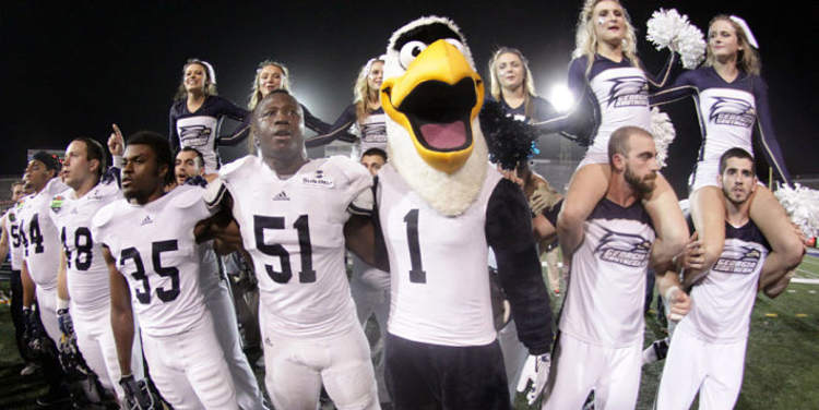 Eagles  team, mascot  and cheerleaders in field