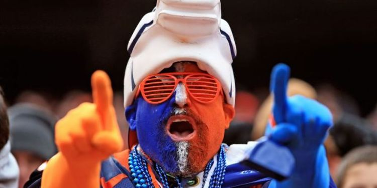 NFL Fan wearing broncos jersey and colts hat