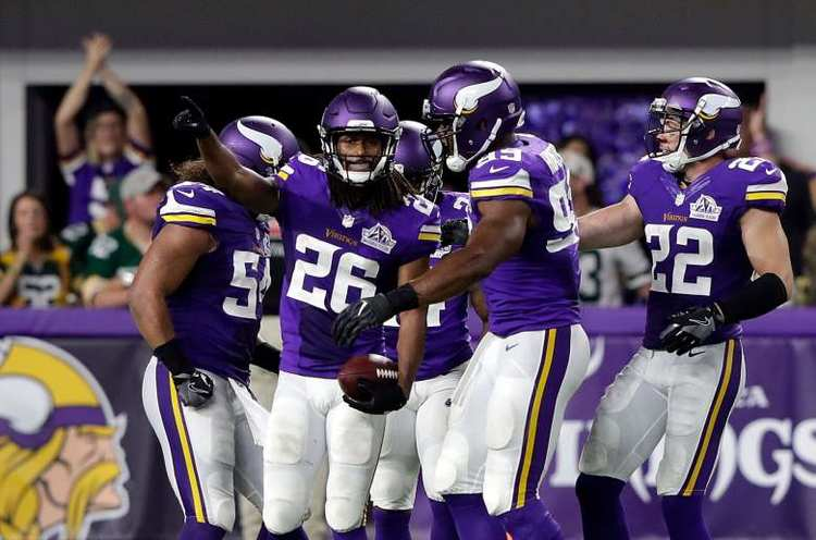 Minnesota Vikings team celebrating during a game