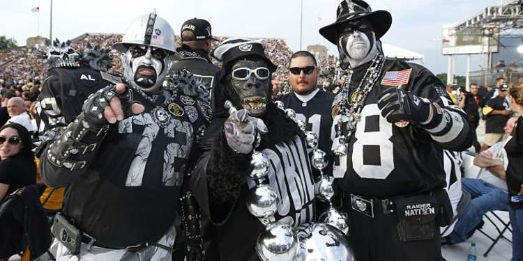 Oakland Raiders fans all dresses up for a game