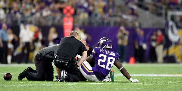 Adrian Peterson gets injured during a game