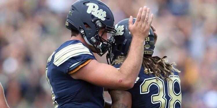 Pittsburgh Panthers QB hugging teammate