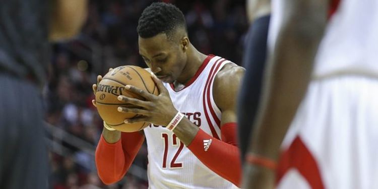 Dwight Howard with the ball in his hands looking down