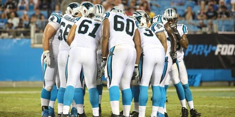 Carolina Panthers team gathered around