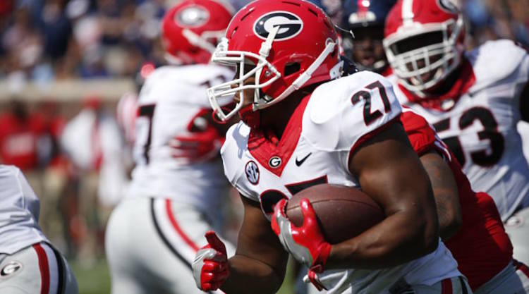 Georgia Bulldogs Player Rushing With Ball