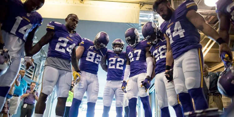Minnesota Vikings players gathered around