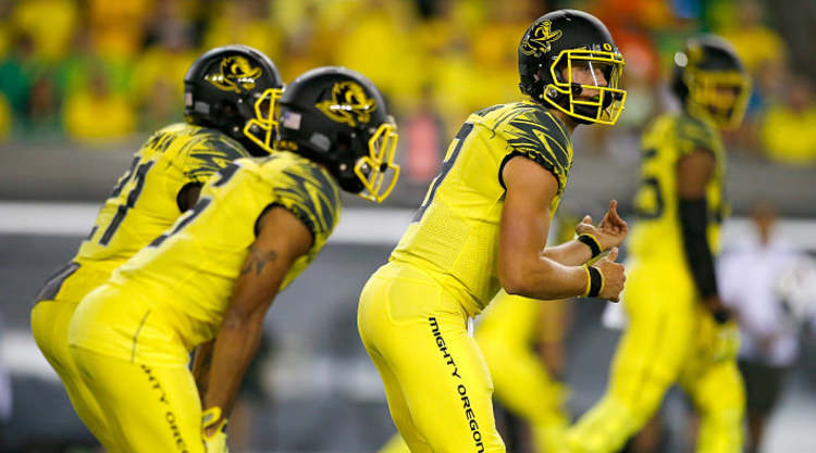 Oregon Ducks Players Get Ready For Snap