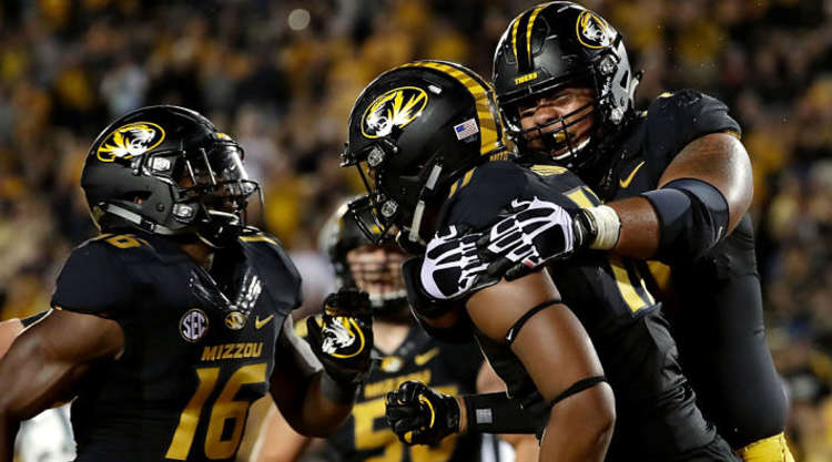 Missouri Tigers Players Embrace