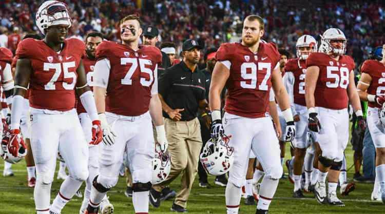 Stanford Cardinal Players Walk Off The Field