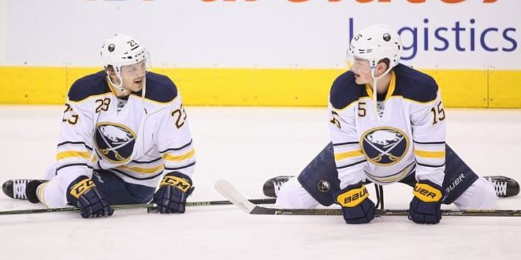 Buffalo Sabres players in the field during a game break