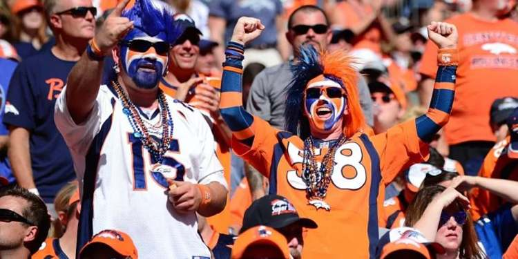 Denver Broncos fans cheering for their team