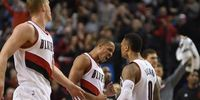 Portland Trail Blazers guards C.J. McCollum (3) and Damian Lillard (0)