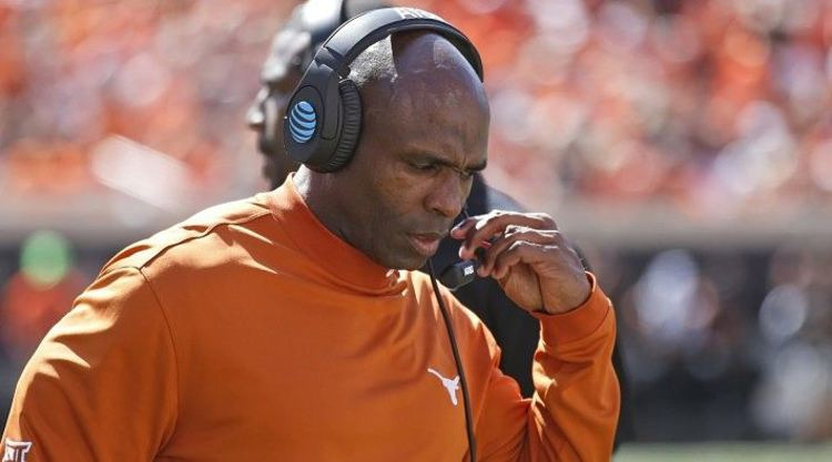 Charlie Strong taking into mic