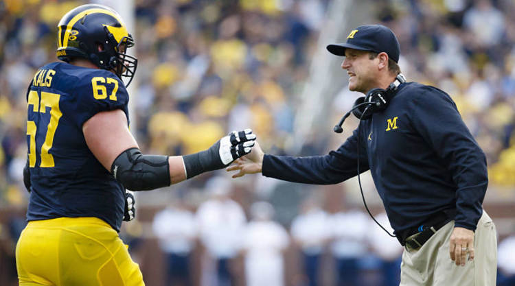 Jim Harbaugh Congratulates A player