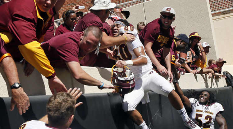 Central Michigan Chippewas Player Celebrates With Fans
