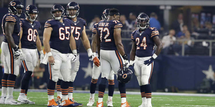 Chicago Bears team gathered around in field