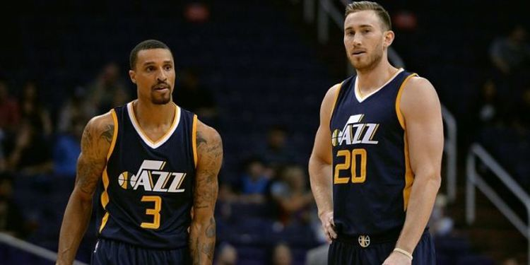 Utah Jazz guard George Hill (3) and forward Gordon Hayward (20) talk mid court during the first half of a game
