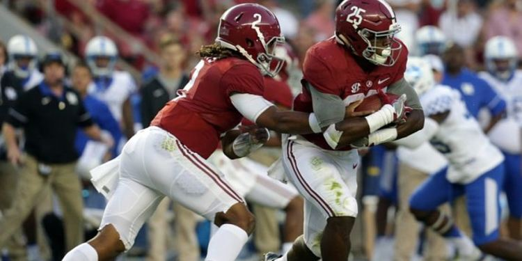 Alabama Crimson Tide players in action