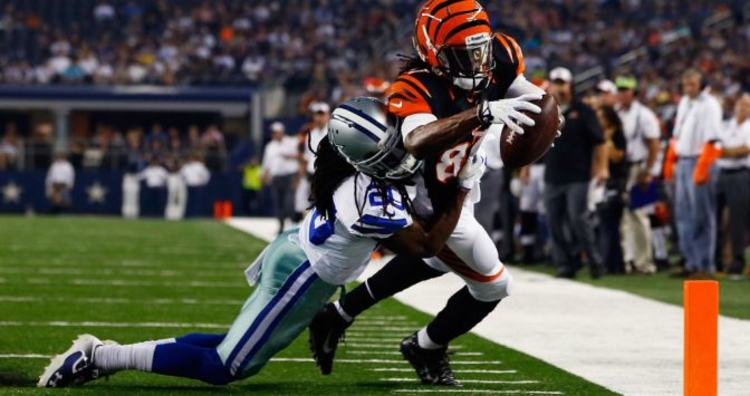 Cowboys player trying to stop Bengals from scoring touchdown