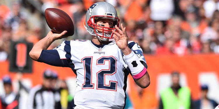 Patriots player Tom Brady in action