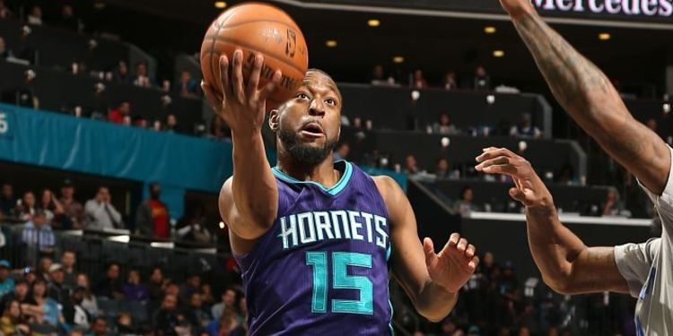 Kemba Walker posing for a picture during a preseason game
