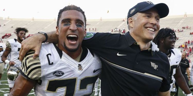 Wake Fortest Player and Coach embrace