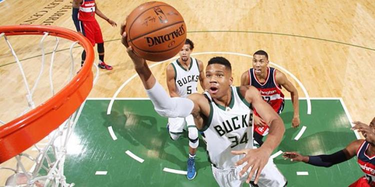 Giannis Antetokounmpo dunks on Nene