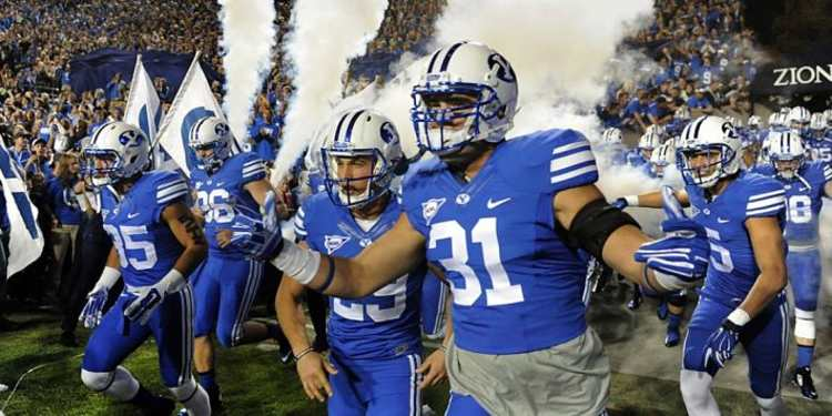 Brigham Young Cougars  players running into field