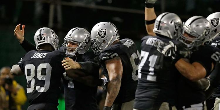 Oakland Raiders players celebrating