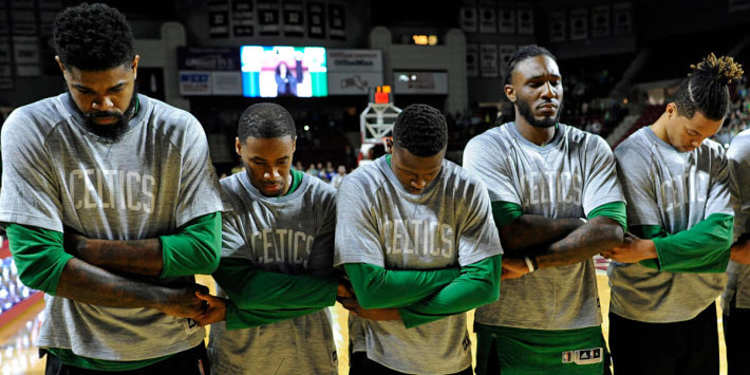 Celtics players cross arms, hold hands during national anthem