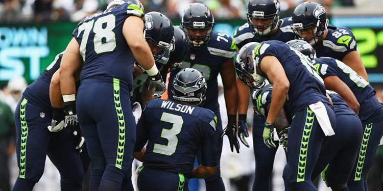Seattle Seahawks players gathered around