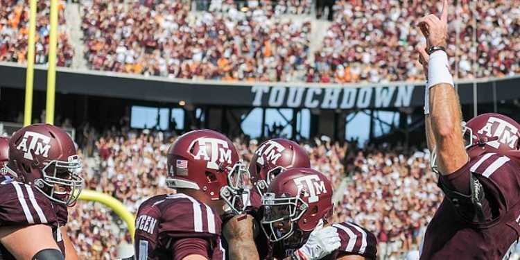 Texas A&M Aggies wide receiver Christian Kirk (3) is swarmed by teammates