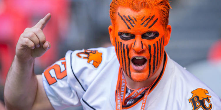 BC Lions fan with orange paint on his face, close up picture