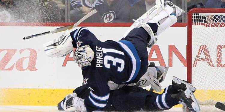 Ondrej Pavelec oof the Winnipeg Jets on the floor