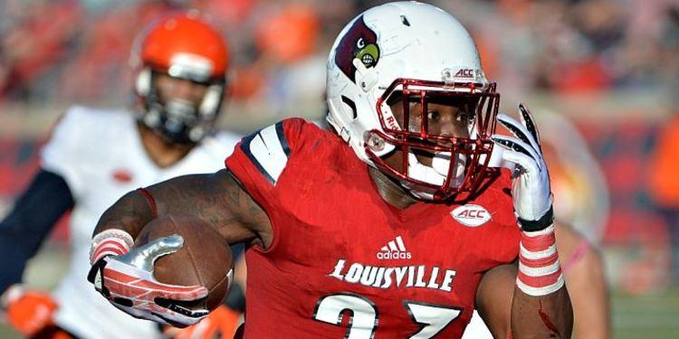 Louisville Cardinals (23) running through the field